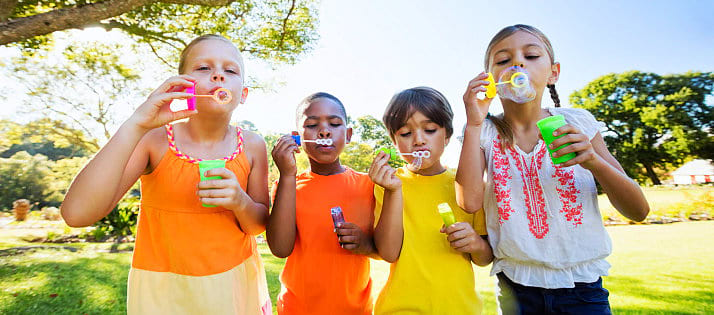Group of children playing bubbles