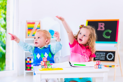 Toddler kid and baby learn letters at child care
